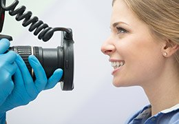Woman having images taken of her smile