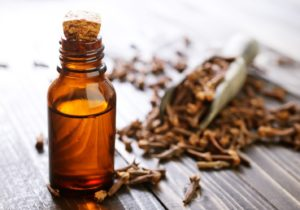 bottle of clove oil, an at-home toothache remedy