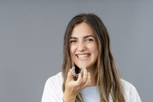 Woman happy with her decision to choose SureSmile over braces